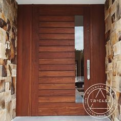 Instalando puerta principal fabricada en madera de #tzalam. Diseño: Arq. J.O…