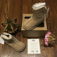 """UGG's Australia toddler baby boo Brand new w tags in box w authenticity 100% authentic. Super adorable toddler color sand baby boo UGG's. DETAILS This moccasin-inspired boot has been crafted from soft suede and lined with plush sheepskin. A reinforced heel and toe keep little feet protected, while elastic cording up the back makes getting the Boo on and off a cinch.  Details:  Suede Sheepskin lining Elastic lace UGGpure™ wool insole Suede and rubber outsole 4 ¼"""" shaft height Price is firm…"""