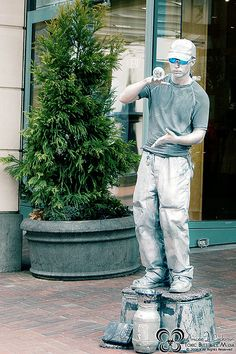 This guy is so cool! I see him just about everytime I go Downtown. I just had to get a picture. Moving To Portland, Downtown Portland, Portland Oregon, Northwest Usa, Oregon Travel, Silver Man, Cities, Destinations, Guy