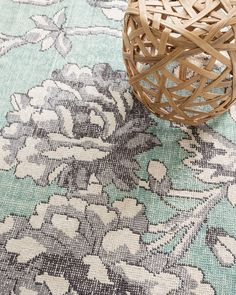 Our Edie wool-blend area rug features a cool shade of aqua blue covered by a sprawling ivory and grey floral design, making it stunning yet demure. To get the look, cotton and wool are first knotted and then sheared by hand, which creates a plush feel, unique mottled appearance, and excellent durability. This rug is an ideal backdrop for your master bedroom, family room, or dining room.