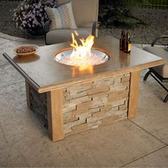 table + fire pit = outdoor party success. http://www.mantelsdirect.com/Products-Accessories/Fireplace-Sale/Sierra-Fire-Pit-with-Ledgestone-and-Supercast-Top-Mocha-SIERRA-CF-M-K #patio #backyard #products