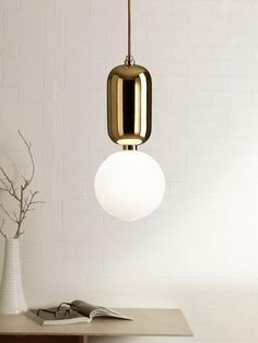 Aballs White Gold Pendant Lamp | Buy Luxury Hanging Lights Online India - A minimal art deco design Pendant Light, the Aballs features a metallic gold cylindrical lamp holder with a white round glass diffuser. The white sphere of the lamp offers diffused ambient lighting and will effortless enhance your home interiors. Room Lights, Hanging Lights, Wall Lights, Ceiling Lights, Luxury Lighting, Lighting Store, Outdoor Lighting, Decoration Lights For Home, Light Decorations