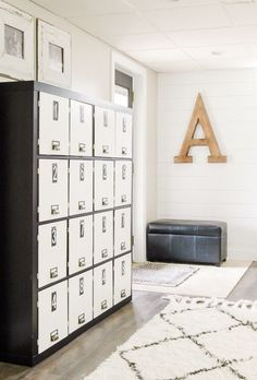 The reason people lovethe EXPEDIT bookcase is because it offers 16cubbies for storage.But this blogger took it to the next level by adding locker doors on the front of each shelf so she could keep her odds and out of sight. See more at Little House of Four »