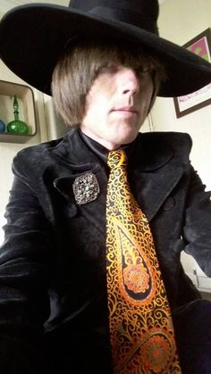 Dandie Fashions styled jacket with kipper tie and black satin shirt by Perfumed Garden Clothing worn by Peter Feely