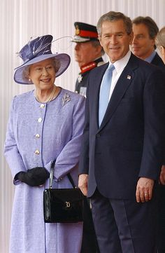 U.S. President George W. Bush is formally welcomed to the U.K. by the Queen, dressed here in a lilac coat and hat. via StyleList } Whatever changes HM did in 2003, she's been looking great ever since.