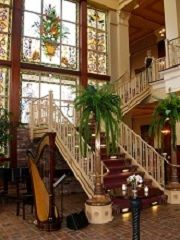 This photo shows the beautiful staircase and stained glass at the Ballroom at Church Street in downtown Orlando