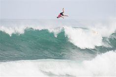 Maxime Huscenot of France flys over the top of a wave at the REEF Hawaiian Pro in North Shore, Hawaii, after deciding it had no scoring pote...