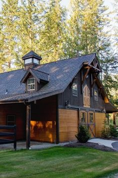 We all love classic barn styles – the gambrel roof, red paint, and X-style doors. For many, this is the outer design they prefer for a barn house! Barn Garage, Garage House, Garage Doors, Metal Building Homes, Building A Shed, Bay Lodge, Gambrel Roof, Pole Barn Homes, Barn Style Homes