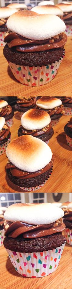 S'mores Cupcakes -- A soft, rich chocolate cupcake topped with milk chocolate frosting, sprinkled with crushed graham crackers, and a toasted marshmallow plopped on top.
