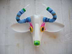 Recycled Plastic Animal Head on Etsy. Don't like the plastic but this is for inspiration.
