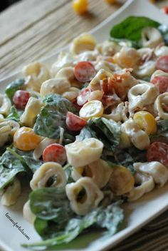 This tortellini salad is tossed with a Greek yogurt dressing, bacon, lettuce and tomato! Perfect BBQ food!