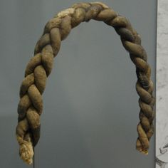 "15th century ""false hair"" braid made of stuffed linen tubes. Kempten, Germany."