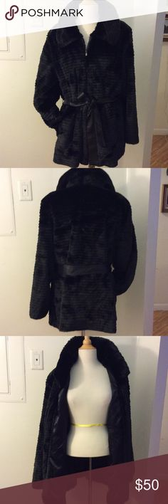 G by Giuliano Rancic Faux Fur Coat-2X Gorgeous Pre-Owned Black Faux Fur Coat. Self tie belt included. Gunmetal zipper. Beautiful satin lining with interior pocket. Exterior slash pockets. Fur is beautifully cut to make staggered lines(see pictures) Finger-tip length. Worn just a few times. I live in hot hot South Florida!! Priced to sell. 🚫No Low ball Offers🚫No Trades. G by Giuliana Rancic Jackets & Coats