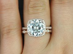 Love the circle diamond with the cushion halo and simple diamond band! Would be beautiful with white gold!