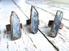 Raw Kyanite ring  Blue Kyanite crystal ring  by HAWKHOUSE on Etsy. I am probably allergic to cooper, but I love the look of it.