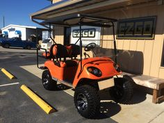 """We call this cart, """"orange is the new black"""" golf cart"""