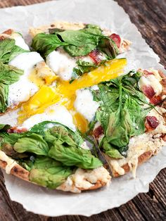 Breakfast Pita Bread Pizza - baked whole wheat pita, fontina cheese, bacon, spinach and egg | Seasons and Suppers
