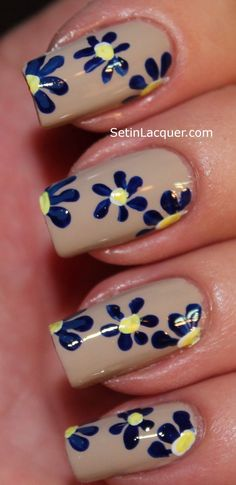 Nude with dark blue dotted flowers nail art design. Might try white nail with red flowers, yellow center. Red nails with white and pink flowers...CL