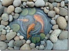Julie Michels paints rocks that are extra-ordinary. Mostly she paints animals, but she added a new dimension to her collection; painting a water scene including koi, lily pads, and a dragonfly on slate. I could not resist! ..diy garden art | Garden Art - DIY Crafty Projects