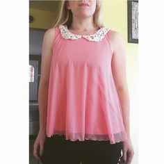 Pink Flowy Lace Peter Pan Collar Top This is a re-posh. I decided not to keep it because I like my tops a little longer. Just me being picky! Really soft and feminine. Cute keyhole in back. I really wish I could keep it. Small mark on inside lining of top that is hardly noticeable while on (see last pic). Candie's Tops