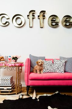 coffee sign, pink couch, bar cart and  the sweetest pup  Cute besides the coffee part lol