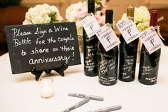 Have Guests Sign Bottles Of Wine To Open On Anniversaries Wedding Guestbook