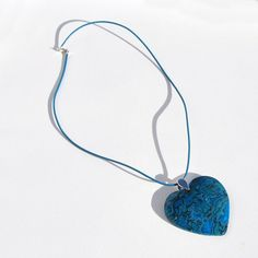 Stunning Blue Ripple Jasper heart pendant will surely be noticed! Its on a sturdy sterling silver bail and strung on a cornflower blue leather