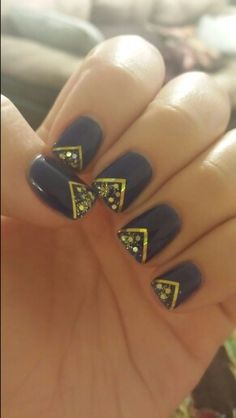 Gel mani with navy blue and gold glitter