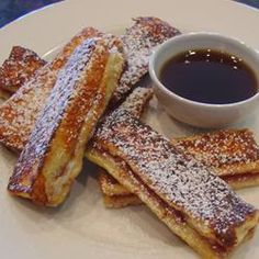French Toast Fingers.     2 eggs      1/4 cup milk      1/4 teaspoon salt      1/2 cup strawberry preserves      8 slices day-old white bread      confectioners' sugar.  In a small bowl, beat eggs, milk and salt; set aside. Spread preserves on four slices of bread; top with the remaining bread. Trim crusts; cut each sandwich into three strips. Dip both sides in egg mixture. Cook on a lightly greased hot griddle for 2 minutes on each side or until golden brown. Dust with confectioners' sugar…