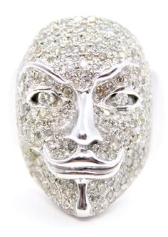 The real Guy Fawkes died in 1605 after a failed attempt to blow up the House of Lords on November of that year. round brilliant cut Diamonds, colour: G/H, clarity: SI, total Diamond weight: Guy Fawkes Mask, Masked Man, Gold Coast, White Gold Diamonds, Masks, Lion Sculpture, Rings For Men, Statue, Jewellery