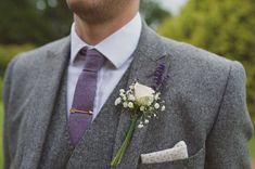 Grey tweed groom suit. White rose and lavender button hole. St Augustine's Priory Bilsington Ashford. Kent Wedding Photographer. Rebecca Douglas Photography - www.rebeccadouglas.co.uk: