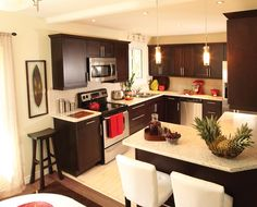 espresso cabinets + red kitchenaid. Pretty--would've been an idea for the property..love the pops of red!!