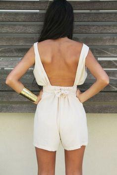 backless white romper & a gold cuff!