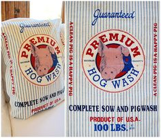 """Go hog wild with this piggy print reproduction grain sack fabric! Fashioned in the style of a vintage feedsack, this farmhouse decor pig fabric has all the fixin's-- ✿ soft CREAM colored grainy cotton with DENIM BLUE ticking ✿ two side by side full prints for front/back design or doubling your project ✿ large center round label with a ROSE PINK piggy with ROYAL BLUE first prize ribbon promoting """"PREMIUM HOG WASH"""" in CRIMSON RED"""