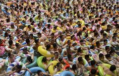 Visitors crowd an artificial wave swimming pool at a tourist resort to escape the summer heat in Daying county of Suining, Sichuan province, China, on July ~ The Week in Pictures: July 9 - 16 - NBC News Summer Heat, Summer Fun, People Around The World, Around The Worlds, Arthus Bertrand, People Crowd, Wave Pool, Photos 2016, Indoor Swimming Pools