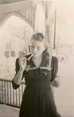 """""""Hey, Jem, here's one of you!"""" Leib handed her the photograph and Jemma took it, feeling the slick cellophane parchment. It was of her, centuries ago, in the middle of lighting a cigarette. She was wearing a casual dress and in the background you could see the barracks of Camp Toccoa. Her hair had been rolled and coifed perfectly. It was like looking at a different woman."""