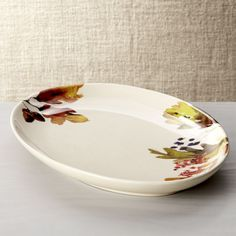 """Autumn Foliage Platter. $29.9515.75""""Wx10.75""""Dx1.75""""H •Artwork by Kelly Ventura •Earthenware with decal •Dishwasher- and microwave-safe •Made in Portugal"""