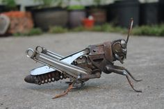 Scrap metal sculpture of a field grasshopper. A species native to the UK. The sculpture in the photos has been sold but I will make them to