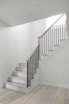 Staircase, Metal Railing, Wood Tread, and Wood Railing Minimal stair with ash treads, white painted Staircase Railing Design, Modern Stair Railing, House Staircase, Wood Railing, Staircase Remodel, Staircase Railings, Modern Stairs, Metal Stairs, Banisters