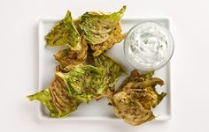 Cabbage chips are the new kale chips, especially when sprinkled with toasted caraway and dipped in dill yogurt.