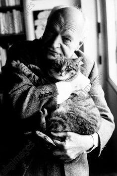 The poet Giuseppe Ungaretti embraces his cat. Milan, 1960s