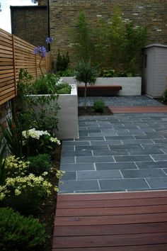 The rich colour of our Green Slate perfectly suits both contemporary and traditional contrasts. Calibrated to it is consistent as well as sophisticated. Slate Paving, Paving Stones, Paving Design, Urban Garden Design, Corner Garden, West London, Open Plan Kitchen, Back Gardens, Backyard Patio