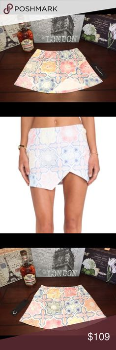 💃🏽For Love & Lemons Mini Skirt- Pink/Blue, XS For Love & Lemons Print Mini Skirt- Pink/Blue, XS  Super cute and brand new! ☺ The main colors are blue, pink, white, and yellow. There's a cute triangle cut-out in front and one side has a functional pocket. The true colors are brighter than the stock pic as shown in additional pics of the actual skirt.   Length- 12 inches Waist- 25 inches (12.5 inches across, but stretchy) Material- 97% Poly/3% Spandex For Love and Lemons Skirts Mini