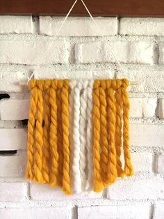 Chunky knit yarn wall hanging - color: mustard yellow & white - handmade