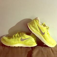 Nike running sneakers lunarglide 4 Nike sneakers. Size 8. Neon yellow color. Super comfortable and great support for runners or just walking around. Nike Shoes Athletic Shoes