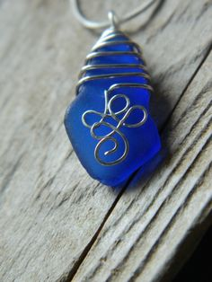 Cobalt blue sea glass pendant by MadeByTheBaySeaGlass on Etsy, $38.00