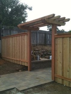 simple wood gate arbor with lengthwise timbers