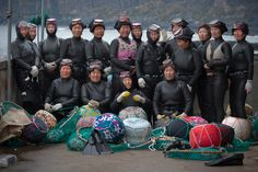 The haenyo diver women of Tae Pyeong pose before their dive