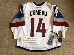 "Blake Comeau Stadium Series jersey worn during the first period of the game at Coors Field on February 27, 2016.  Video matched to the mark over the ""C"" on the name plate."