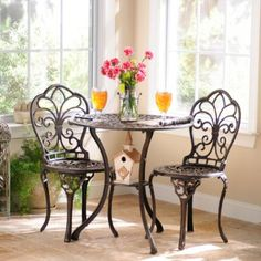 Transform your patio into a quaint cafe with the Fleur-de-Lis Cast Iron Bistro Set. Crafted of cast iron, it strikes a balance between design and art. Iron Furniture, Patio Furniture Sets, Furniture Ideas, Furniture Design, Wicker Furniture, Patio Table, Table And Chairs, Bistro Set, Bistro Tables